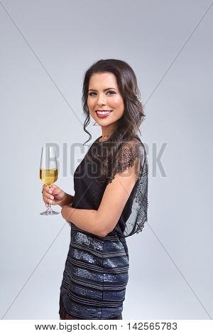 Portrait of beautiful glamoros mixed race woman holding a champagne glass