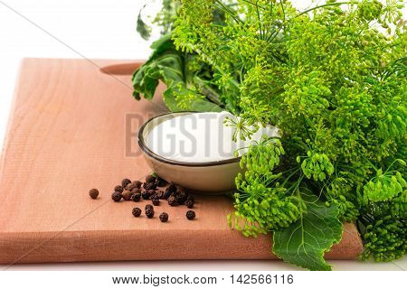 Bloom dill with black pepper on the cutting board