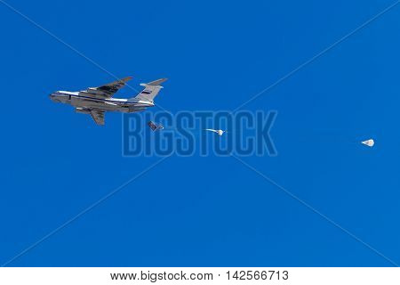 August 6 2016. Ryazan Russia. Russian army airplane drops Military cargo parachute with armored vehicle at military exercise. Documentary Editorial Image.