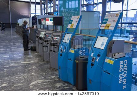 OSLO GARDERMOEN NORWAY - NOVEMBER 3: Check in machine at Oslo Gardermoen International Airport on november 3 2014 in Oslo. The airport has biggest passenger flow in Norway.