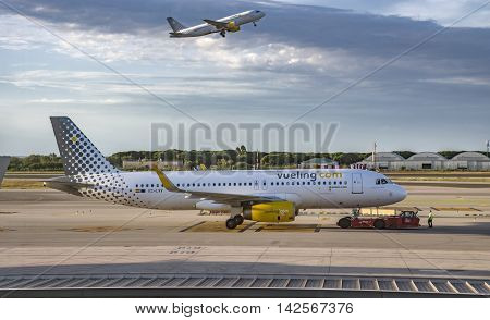 BARCELONA SPAIN - JULY 14 2016: Aircraft of Vueling Airlines at the gate in Terminal T1 of El Prat-Barcelona airport.