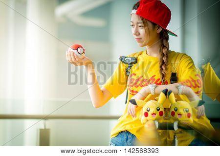 BANGKOK THAILAND – August 14 2016: Trainer girl playing pokemon