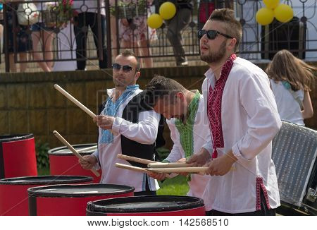 Kiev Ukraine - June 05 2016: Trio of drummers in national costume stands in front of the audience