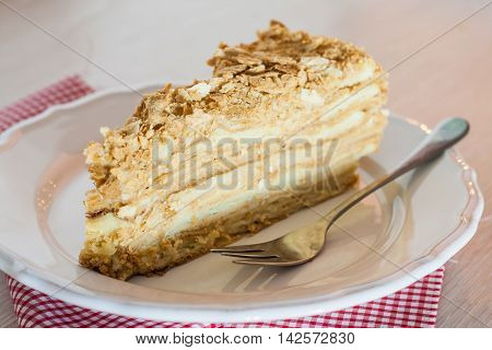 Cut Piece Of Cake Napoleon With A Fork On A Plate