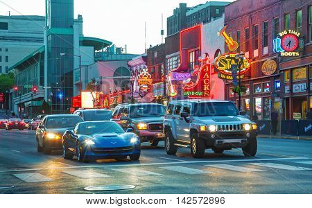 NASHVILLE - AUGUST 28: Downtown Nashville with people in the evening on August 28 2015 in Nashville TN. Nashville is the capital of the State of Tennessee and the county seat of Davidson County.