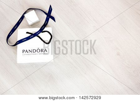 Moscow, Russia - 08.14.2016: Pandora carrier Bag on a white background, Pandora is famous its Bracelets, Charms and Jewelry. place for text