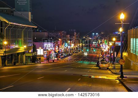 NASHVILLE - AUGUST 28: Downtown Nashville with people at night on August 28 2015 in Nashville TN. Nashville is the capital of the State of Tennessee and the county seat of Davidson County.