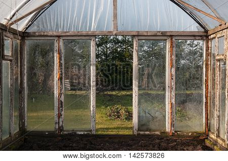 Old warm house with fogged, dirty glasses and wooden frames.