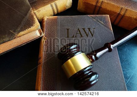 Old law books and legal court gavel