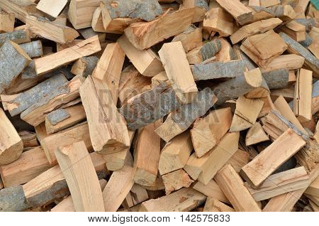 Pile of cut logs as a natural look background
