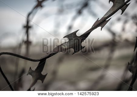 stabbing sharp fence on blurred black and white background