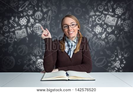 cute student siting front open book with illustrated school tools in background