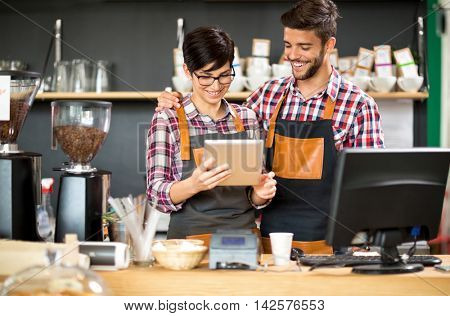 take bill satisfied shop owner on table