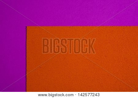 Eva foam ethylene vinyl acetate sponge plush orange surface on pink smooth background