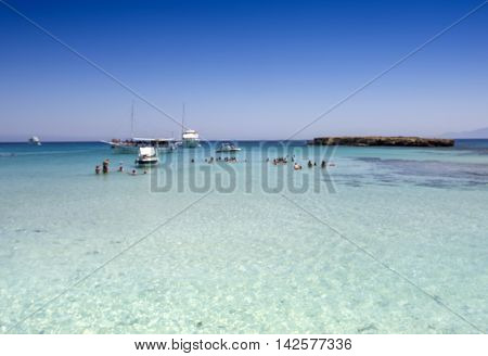 Blur background Tour boats moor in the clear turquoise water of popular tourist attraction Blue Lagoon on a sunny day
