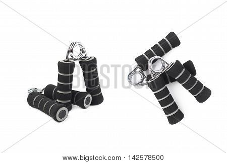 Composition of two black carpal expander training devices isolated over the white background, set of two different foreshortenings