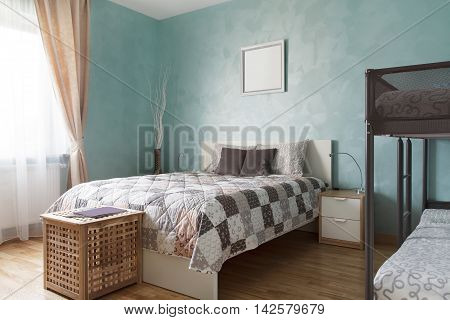 Bedroom with a double and a two-tier beds. Interior design