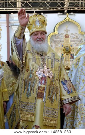 Kiev Ukraine celebration liturgy in honor of the baptism of Rus in Kiev Pechersk Lavra - 27 July 2013 -: Patriarch Kirill Gundyaev welcomes people standing and waving his hand lifting it up