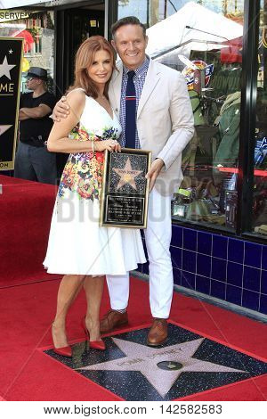 LOS ANGELES - AUG 11: Roma Downey, Mark Burnett at a ceremony where Roma Downey is honored with a star on the Hollywood Walk of Fame on August 11, 2016 in Los Angeles, California