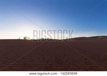 Red Sand Dunes In Mui Ne Village On Sunset, Vietnam