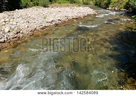 image of mountain river flowing in a canyon
