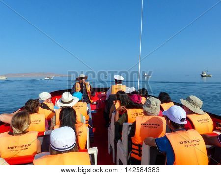 Paracas, Peru-january 26: Unidentified People Sit In A Tour Boat January 26, 2015  In Pisco Bay, Per