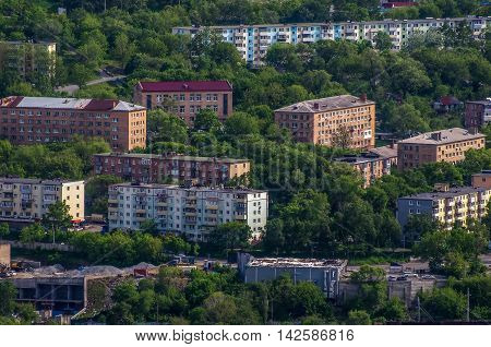 Banks of houses among the trees in city Vladivostok