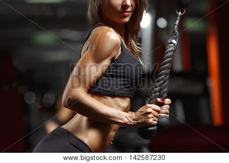Fitness woman in the gym. Young woman doing fitness exercises in the gym.