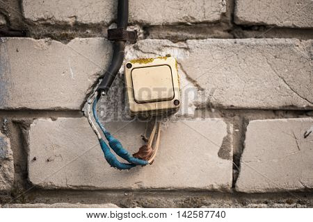 The Old Switch On The Brick Wall, Twisted The Blue Tape.