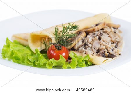 Pancakes with meat and mushrooms on plate on a white background isolated