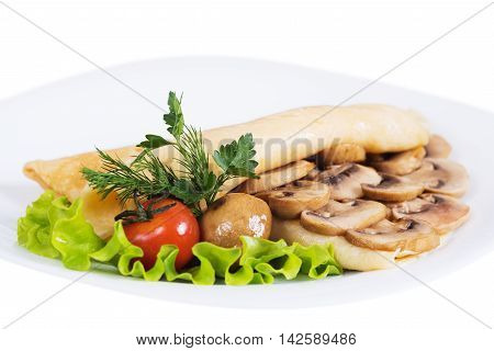 Pancakes with mushrooms on plate on a white background isolated