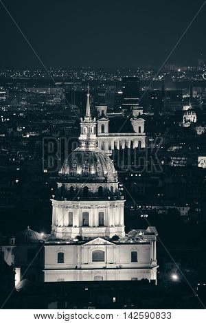 Paris city skyline rooftop view with Napoleon's tomb at night, France.