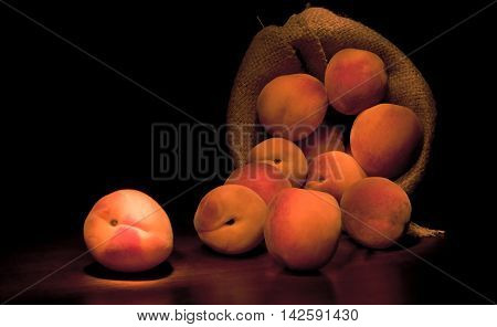 Fresh Ripe Juicy Whole Red Peaches In On Rough Black Background.
