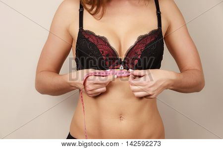 Woman In Bra Measuring Her Chest Breast