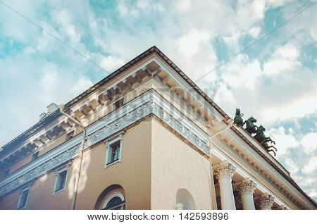 Saint-Petersburg Russia - August 12 2016: Element of the Alexandrinsky Theatre or Russian State Pushkin Academy Drama Theater on Ostrovsky Square with blue sky background.