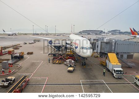 HONG KONG - MAY 12, 2016: jet flight docked in Hong Kong Airport. Hong Kong International Airport is the main airport in Hong Kong. It is located on the island of Chek Lap Kok