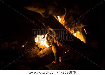 a glowing beach bonfire on summer night