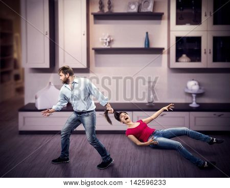 Man pulling woman by the hair