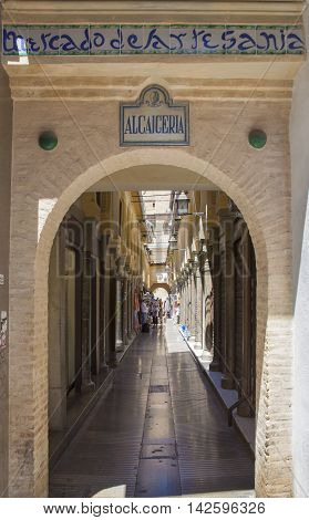 Granada Spain - August 5 2016: Alcaiceria Market entrance. Narrow streets filled with shops called Alcaiceria originally home to a Moorish silk market Granada Spain