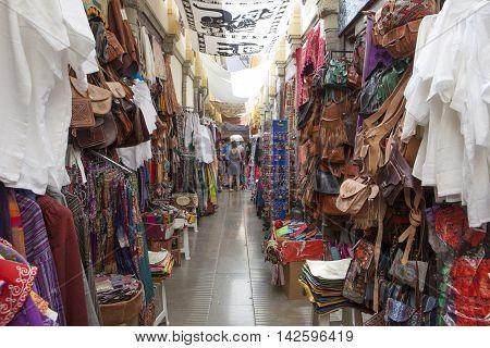 Granada Spain - August 5 2016: Narrow streets filled with shops called Alcaiceria originally home to a Moorish silk market Granada Spain