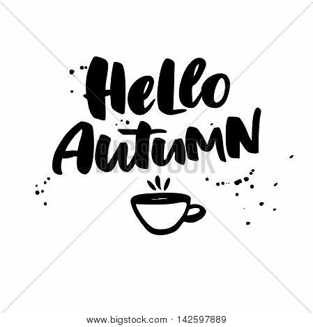 Hello Autumn. Fall vector lettering with cup of tea and ink splashes. Seasonal isolated handwritten quote. Modern brush calligraphy. Hand lettering for posters invitations cards t shirt