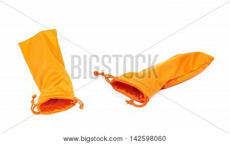 Protection orange pouch bag with the drawstrings isolated over the white background, set of two different foreshortenings