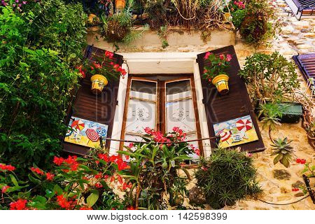 decorative window in the old town of Antibes Cote Azur France