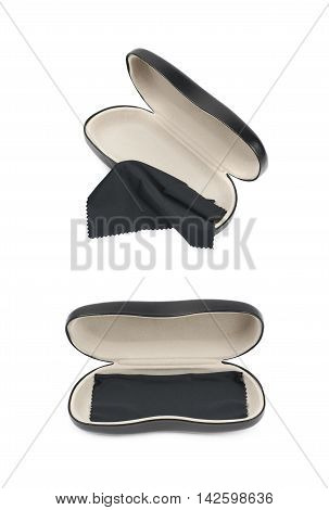 Opened black leather protection case box for glasses with the cleaning napkin cloth over it, composition isolated over the white background, set of two different foreshortenings