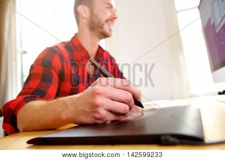 Middle Age Designer Working On Desktop With Stylus Pen