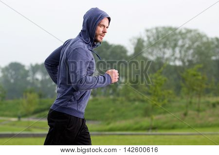 Healthy Middle Age Runner In Park