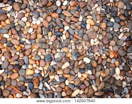 walkway texture with stones or massage stones background