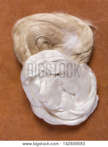 White and beige silk tops in their raw unprocessed form