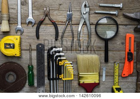 Old tools on a old wooden table