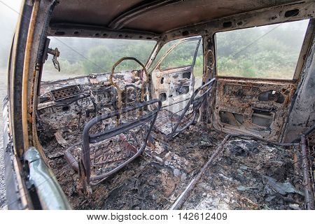 The Inside Of A Burnt Out Car Just The Shell Remains.